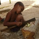 A 3 year old using a machete. The best way to learn!